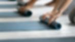 Students roll up Yoga mats 1.png