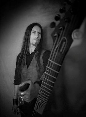 gwen kerjan holding a guitar at slab sound studio