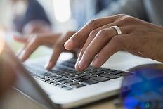 Man Typing on a Laptop