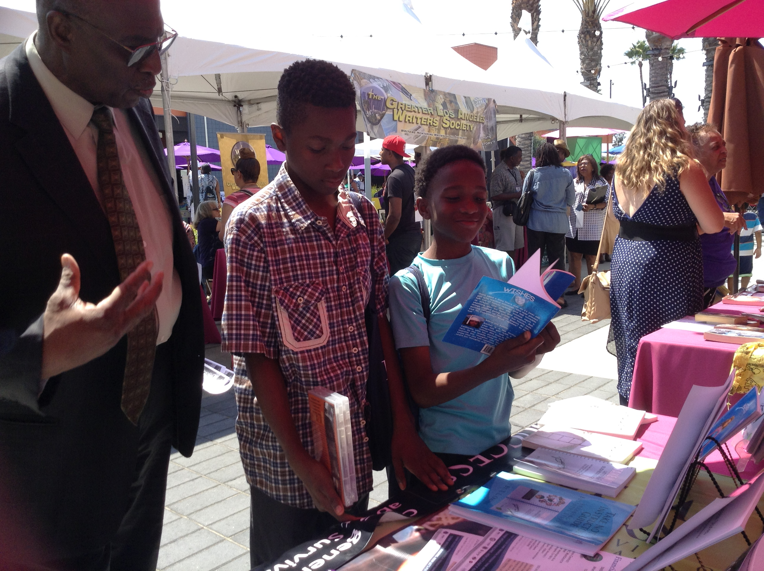 14 Baldwin Hills Leimert Park Book Fair visitors with Charles Barnes