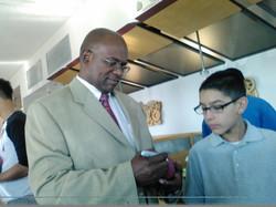 reginald Grant signing an autograph