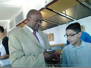 reginald Grant signing an autograph.jpg