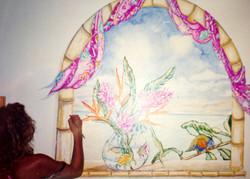 Helen Eltis painting a window