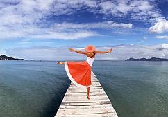 woman-happy-dance-beach.jpg