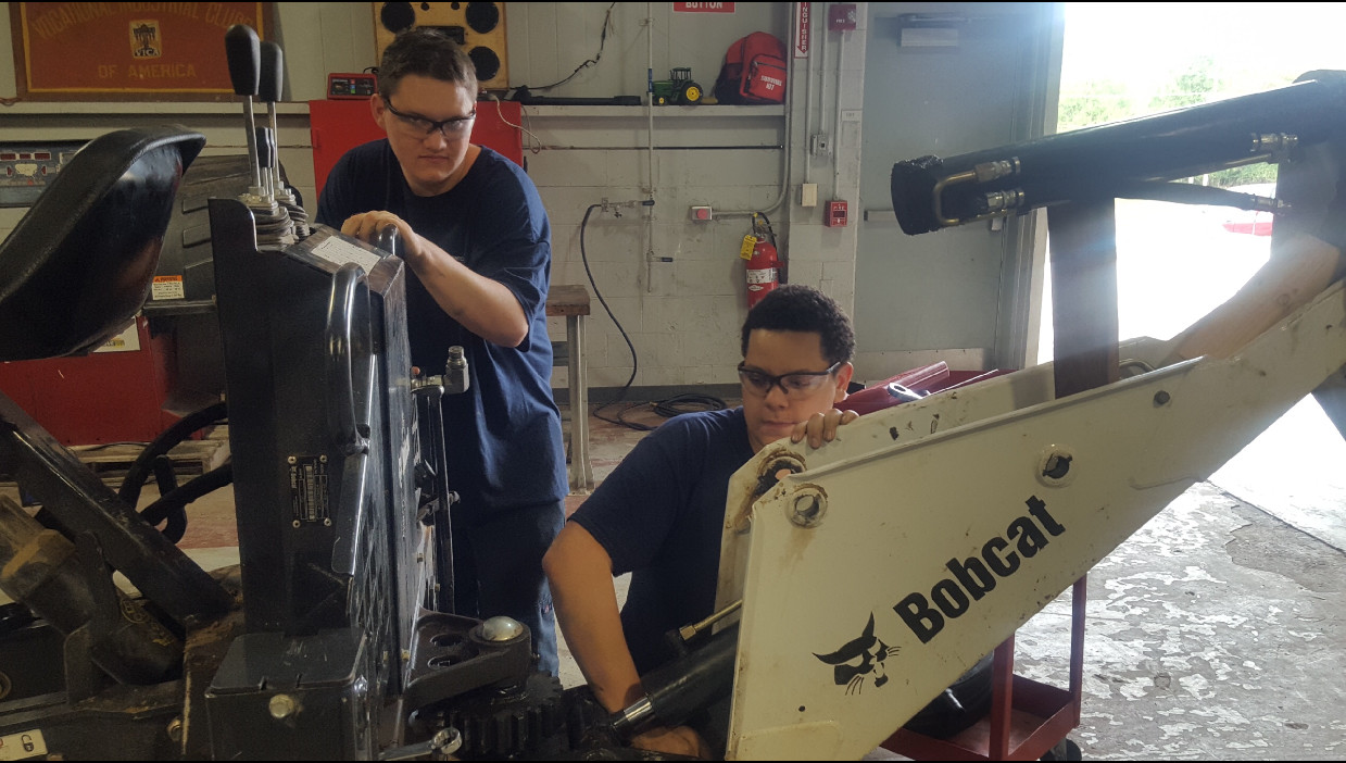 Students working on Bobcat.jpg