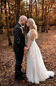 Bride and groom fall by the trees.jpg