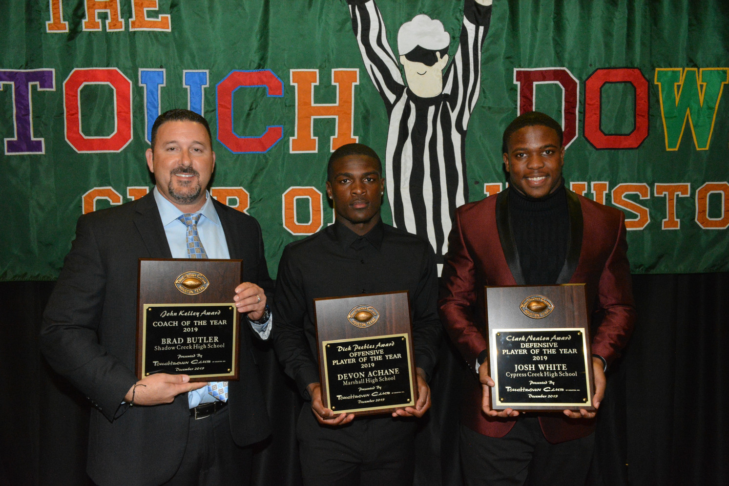 Winners from the UIL High School Awards Dinner in 2019 are, from left, Coach of the Year Brad Butler of Shadow Creek High School; Offensive Player of the Year Devon Archane of Thurgood Marshall High School; and Defensive Player of the Year Josh White of Cypress Creek High School.
