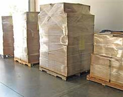 Boxes wrapped in clear plastic on pallet
