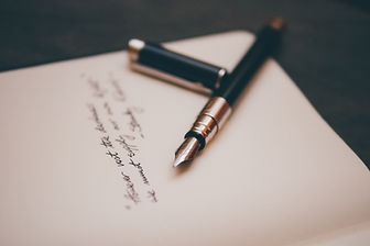 Stylish pen on paper with handwritten words