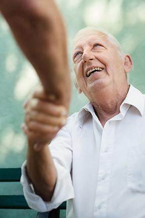 Elderly man shaking hands