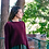 A boxy, boat neck sweater with a seed stitch texture on the top.