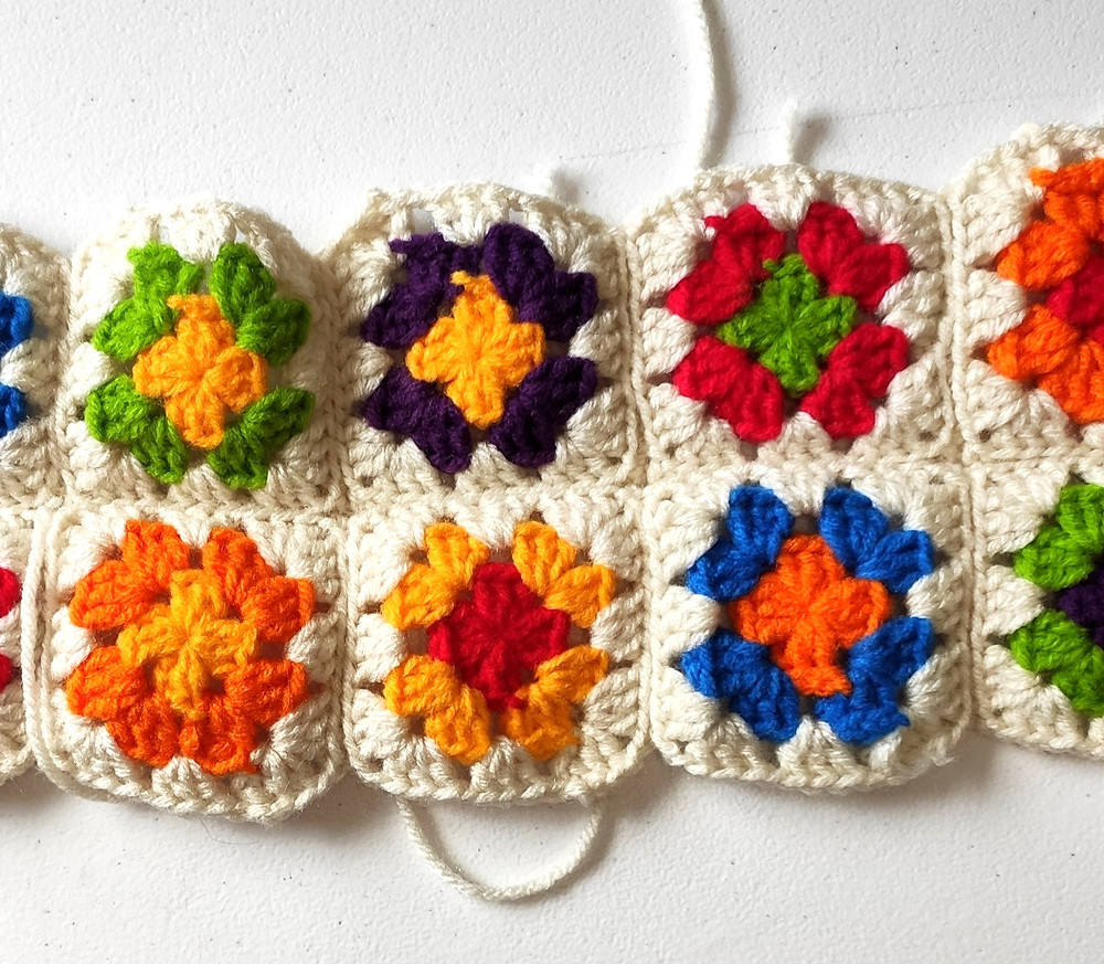 the multi-colored granny squares seamed together.