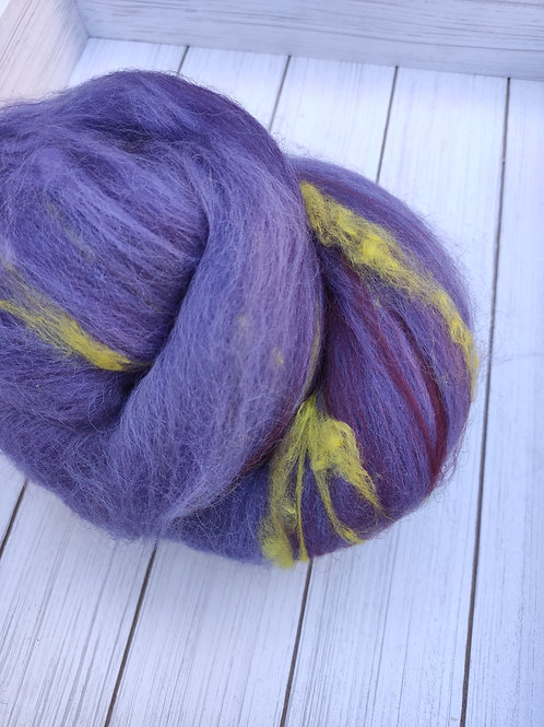 Batt made with purples and pops of yellow.
