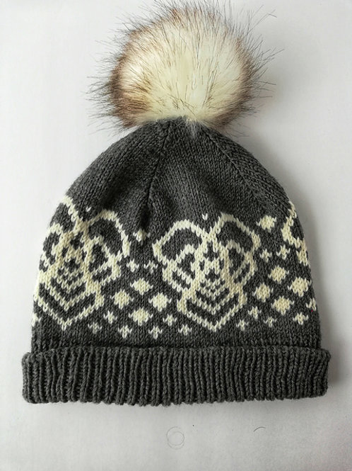 A slouchy beanie with a stranded colorwork pattern including Mamaidh motifs and diamonds.