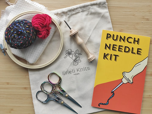 punch needle kit: punch needle, manual, bag, scissors, yarn, hoop, and monk's cloth.