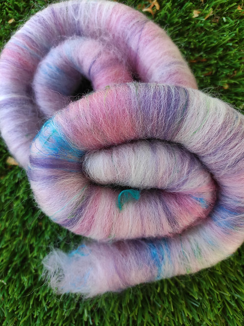 pink, purple, and white rolags with blue and green silk.