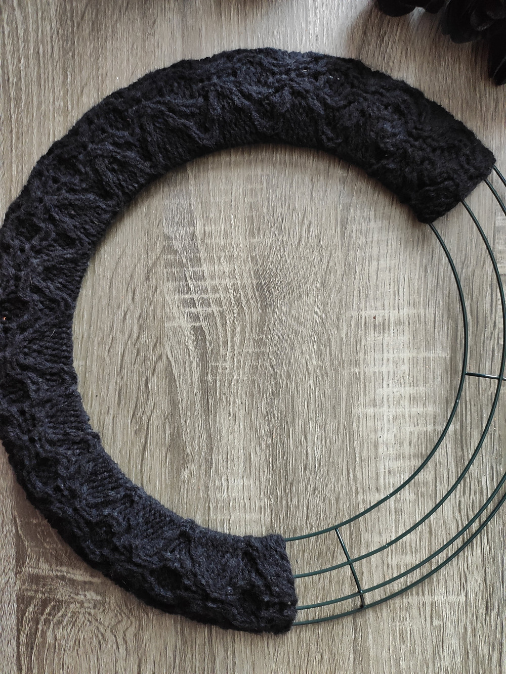 right side of wreath with the knit fabric now covering two thirds of it.
