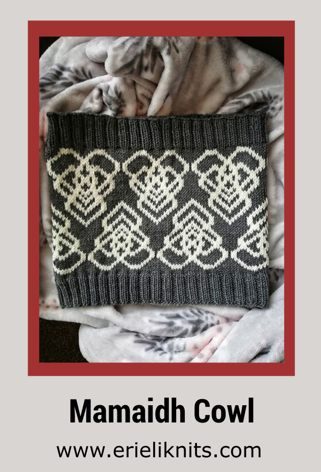 a stranded colorwork cowl with the mamaidh symbol repeated on it.
