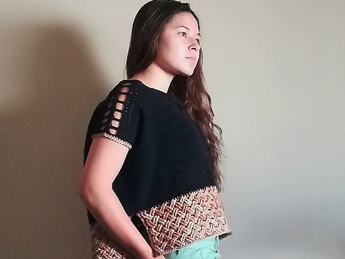 A boxy crocheted top with a thick woven hem and lace eyelets on the shoulders.