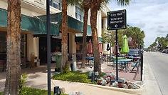Sidewalk cafe, floral plantings, attractive directional signage