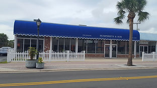 facade of humphries jewelers with blue awning