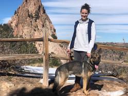 Shep on trail w owner.jpg