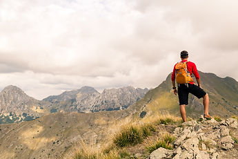 hiking-man-or-trail-runner-in-mountains-
