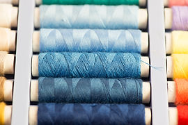 Cotton reels in varying shades of blue