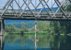 Aerial doubles over a bridge