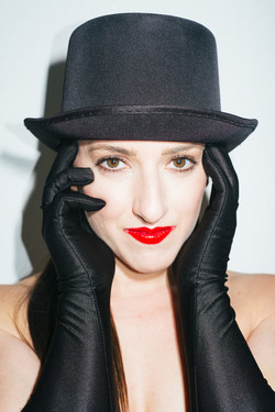Theatrical headshot with gloves