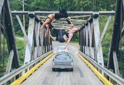 Aerial hoop doubles on a bridge