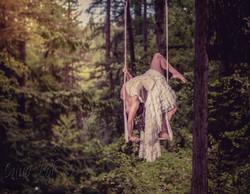 Wedding dress trapeze backbend