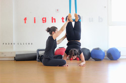 Teaching forearm stand in aerial