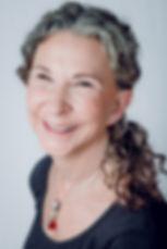 Judith Smiling headshot (dasha) edited.j
