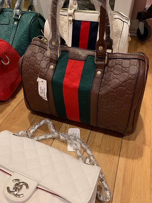 Embossed striped brown GG speedy handbag
