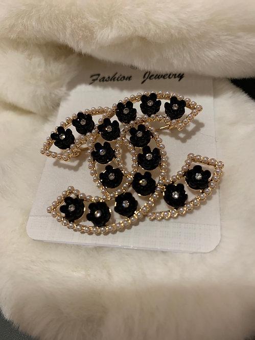 Gold Black rhinestone CC brooch
