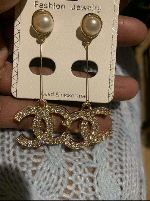 Dangling Cc earrings  gold