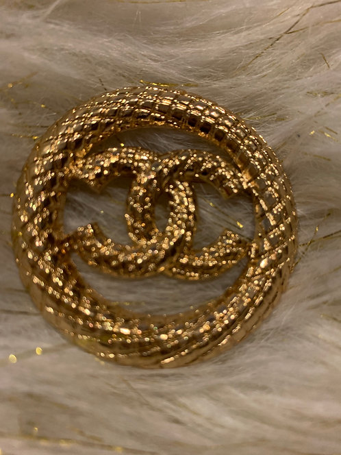 Vintage gold CC brooch