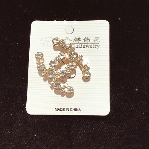 CC diamond brooch