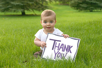 Baby with a Thank You Sign.jpg