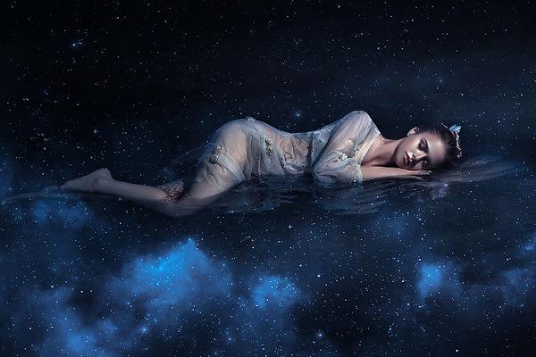 Girl sleeps in space among stars night s
