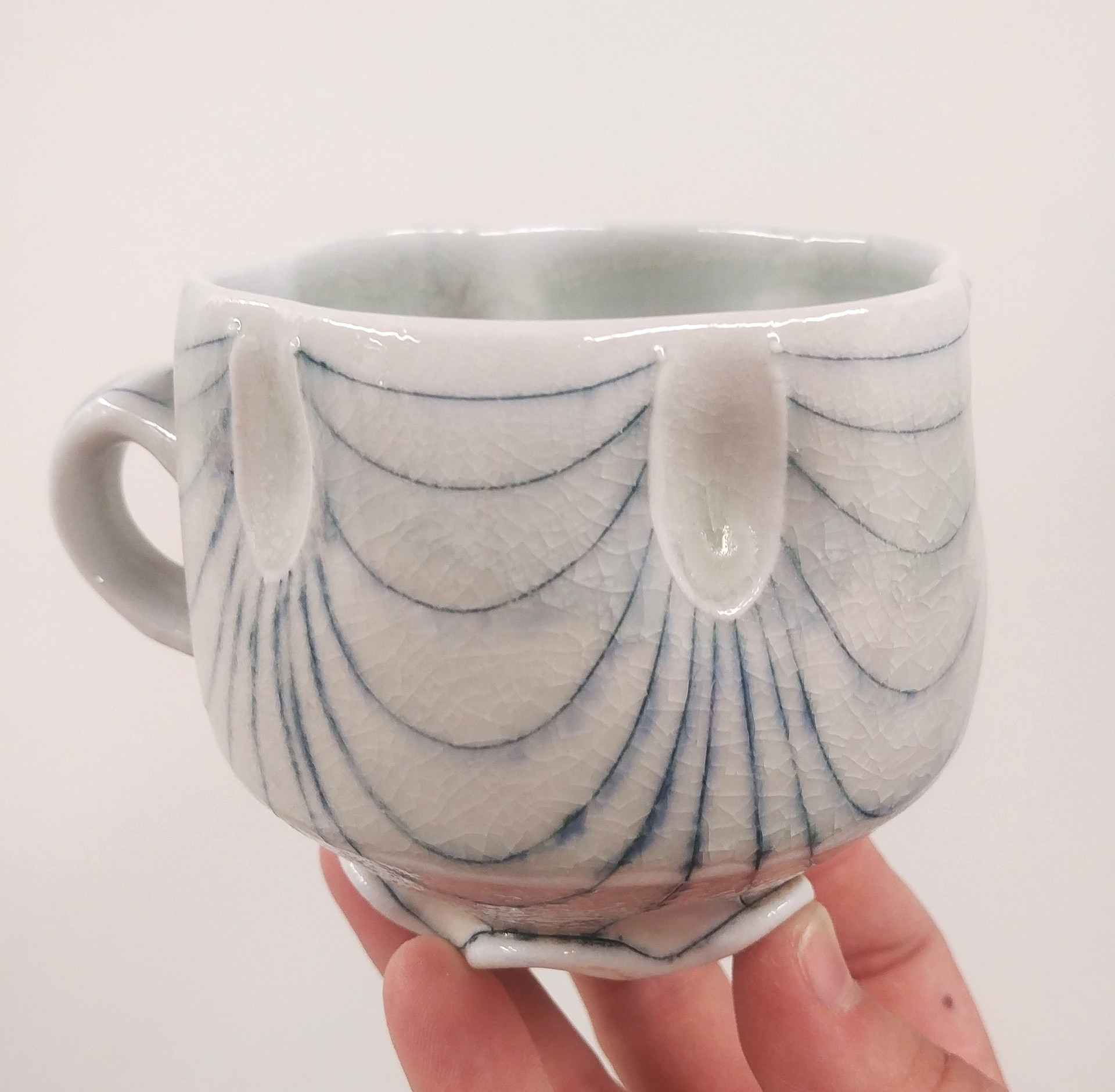 thrown, altered, and incised porcelain mug