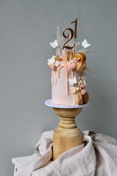 Birthday drip cake details with macarons