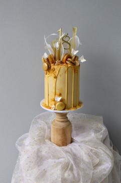 Yellow drip birthday cake