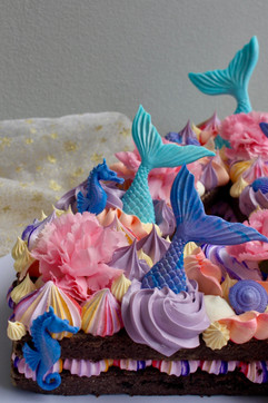 number cake with mermaid decorations