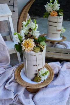 Semi-naked rustic floral cake with macar