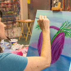 An artful dreamer painting her vision.