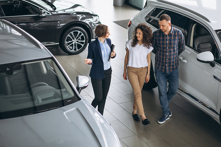 young-couple-talking-sales-person-car-sh