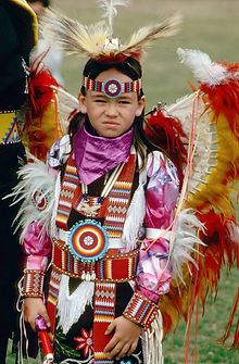 A Cheyenne Indian boy dressed for an Indian dance.