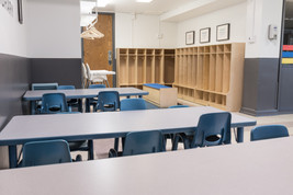 PTLL interior, kid-sized tables and chairs, high chairs, wooden cubbies